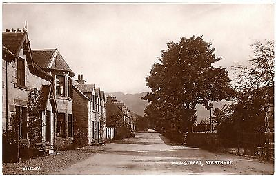 Real Photo Postcard Buchanan? Monument-Women-Large Houses-Main Street-Strathyre