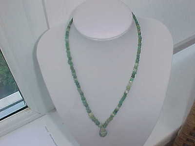 string of  Roman green   coloured  glass beads circa 100-400 A.D.