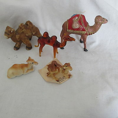 Lot of 5 camels Various sizes glass pottery plastic various sizes