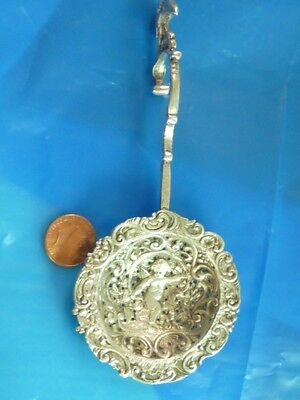 Antique silver coin silver Tea Strainer with angel and Eagle atop the handle