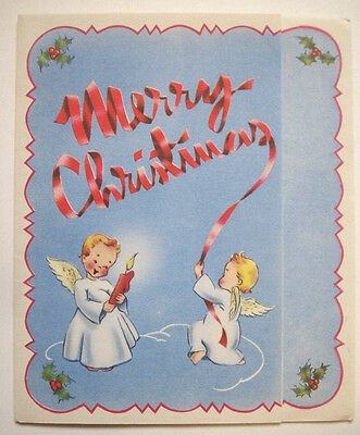 Angels use ribbon & candles  vintage Christmas greeting card A*