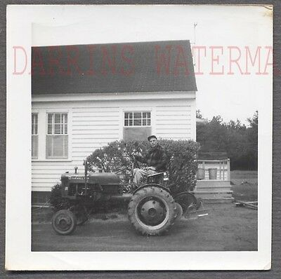 Vintage Photo Man on McCormick Deering Farmall Cub Farming Tractor 717402
