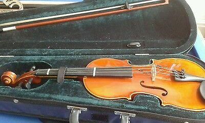 1/2 size violin with bow and rosin in a hard carry case