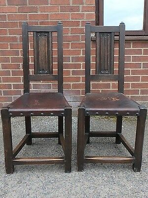 Pair 2 Edwardian antique Arts Crafts solid oak leather linen fold carved chairs