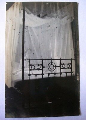 1908 Behind Mosquito Nets Egypt Postcard Woman in Bed Postcard. A little spooky!