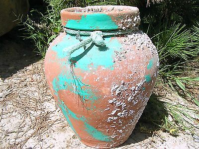 Old hand thrown clay terracotta Octopus fishing clay buoy pot with barnacles