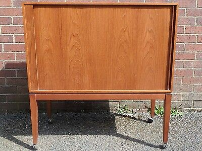 1960s vintage Danish style teak tambour roll front record side cabinet bookcase
