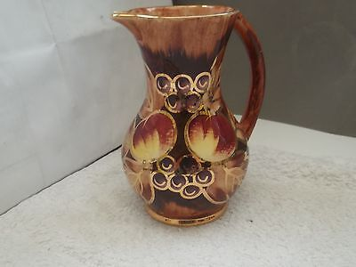 Shaped Oldcourt Ware Jug With A Fruit, Leaf And Berry Pattern