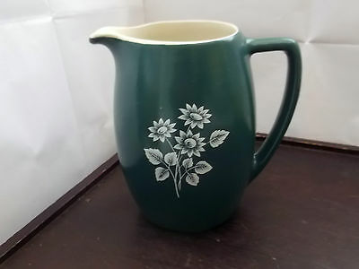 Large Size Dark Green Devon Pottery Jug With A White Floral Pattern