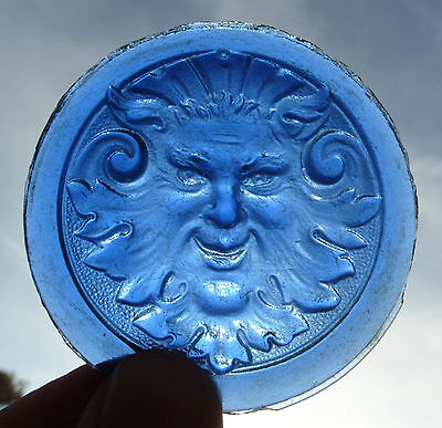 1890's Stained Glass medallion in molded glass representing a Faun mask