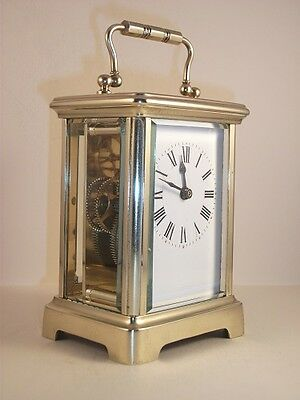 Antique French carriage clock (C 1910) with key. Perfect working order..