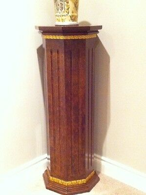 Stand / Pedestal European Antique. Walnut wood with carvings and gold details.