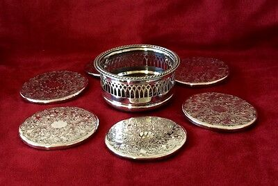 set of six silver plated coasters in their own wine bottle stand