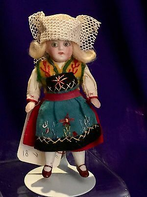 """4"""" ANTIQUE ALL BISQUE GIRL REGIONAL DRESS w WHITE WINGED HAT ALL ORIGINAL"""