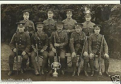 WW1 era postcard Group  East Lancashire TF shooting team with two officer