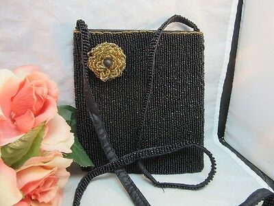 Vtg black beaded purse with gold beads flower