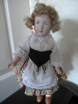 doll real seeley body porcelain head curly hair and dressed