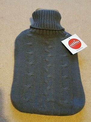 Hot water bottle with grey knitted cover