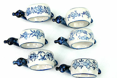 Six Ceramic Snail Napkin Rings With Different Blue And White Designs