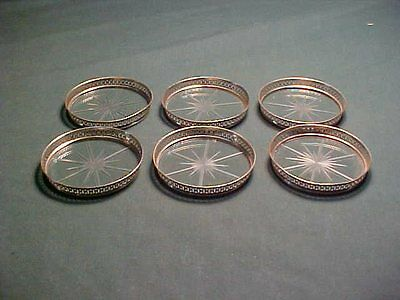 Six Cut Glass and Sterling Silver Coasters