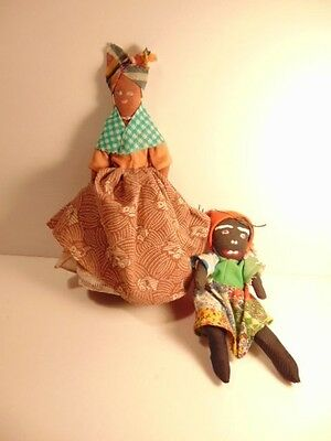 2 pre-owned souvenir dolls from the Caribbean Islands
