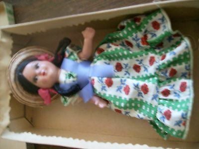 Old composition mexican  doll in original box