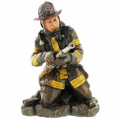 Fireman Holding Hose Figurine. Unique decorative statement in any room. NEW