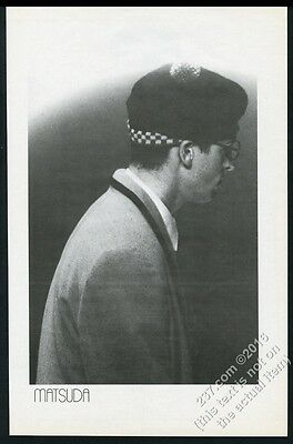 1986 Matsuda fashion man in coat and hat photo vintage print ad