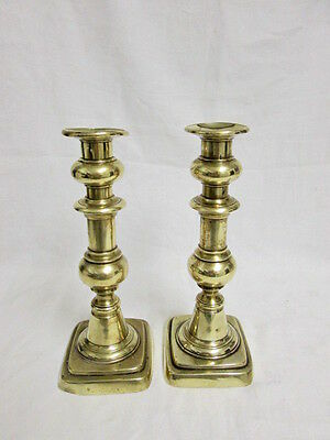 A Pair of Victorian / Edwardian Brass Candlesticks with Ejecters