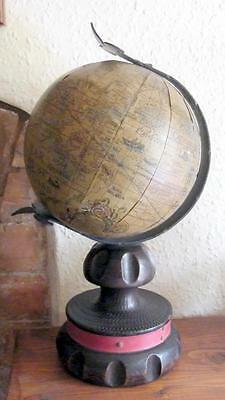 Replica of a 16th century globe on stand with wrought iron work