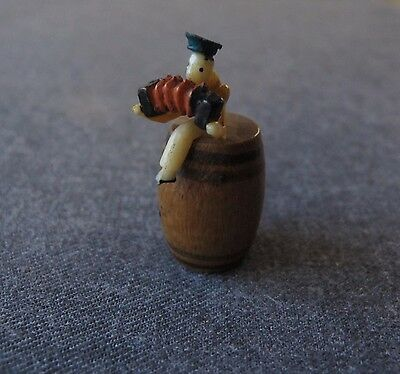 Vintage Miniature Celluloid Sailor Playing The Accordion On A Wooden Barrel Toy