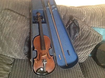 Vintage violin for restoration.
