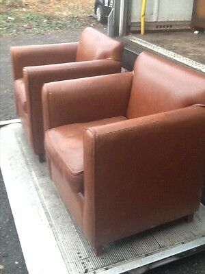 pair of french style deco shape leather chairs