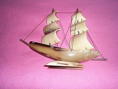 bone sailing boat 10 inches long 8 inches tall and 2.5 inches depth ornament