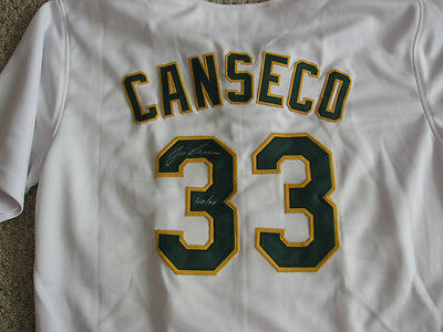 Oakland A's Jose Canseco signed jersey W/COA  with 40/40 inscrpition