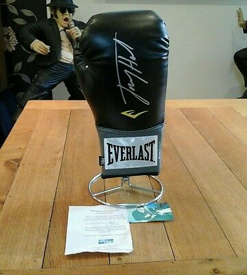 Larry Holmes hand signed boxing glove world champion With COA and stand