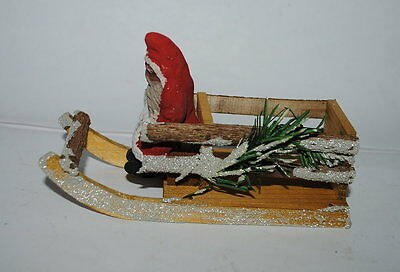"""EARLY GERMAN SANTA ON WOODEN SLEIGH , MICA SIDES, 5"""" LONG,yellow"""