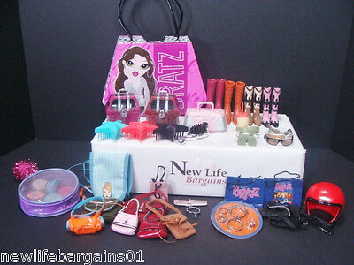 Bratz Bundle w/ carry on purse,boots, purses, make up, sunglasses, and much more