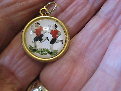 Soccer players or Runners vintage intaglio cab pendant Reverse carved & painted