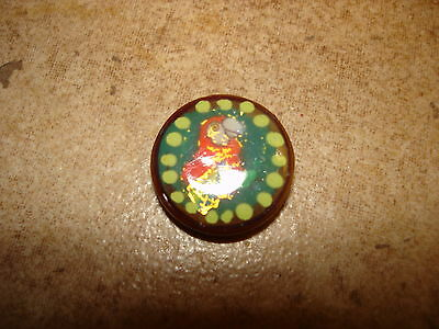 Vegetable ivory button with tropical bird.