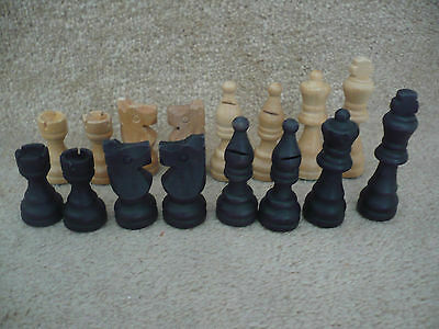 A Collection Of Wooden Chess Pieces