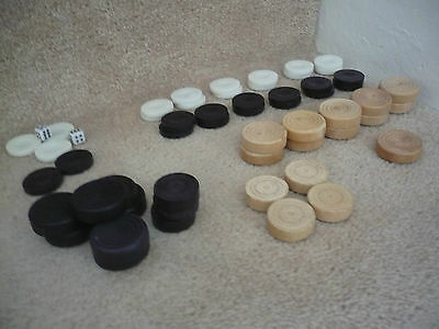 A Mixed Set Of Draughts Wooden And Plastic