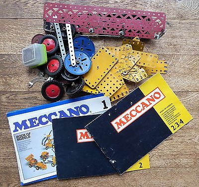 A bag of vintage metal Meccano parts with instruction booklets ##REC73BS