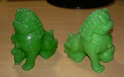 Carved lion X 2 Jade Green. 4 inch. Vintage  Material unknown.