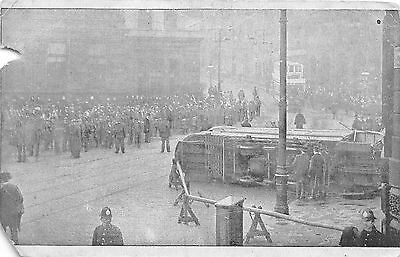Early 1900s Overturned Double Deck Trolley Postcard #22840