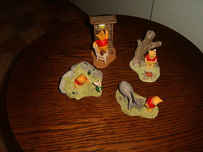4 Disney Winnie The Pooh resin figures approx. 3 to 4 inches height/width