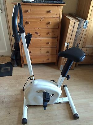 White Heavy Exercise Bike. Adjustable Seat/handles/tightening Pedals .used.