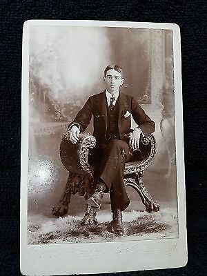 Young Man Sitting in Claw Foot Curved Hand Carved Chair - Stamford, New York