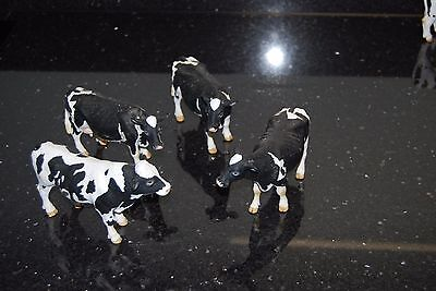 Friesian cows x 3 and 1 x Friesian bull made by German Company Schleich