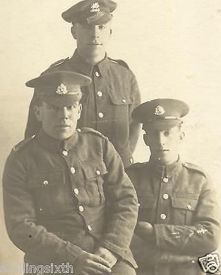 WW1 era postcard SUFFOLK REGT  with SCOUT trade badge